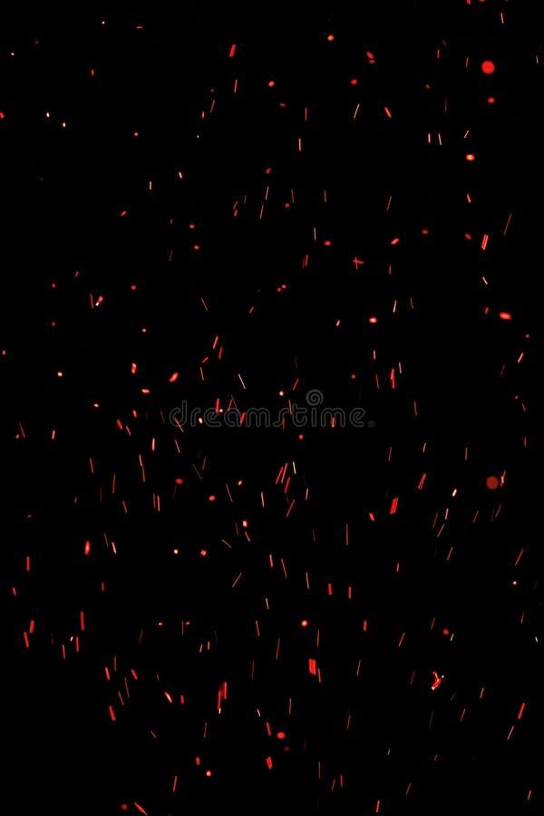 De röda orange gnistorna från en signalljus avfyrar royaltyfri bild