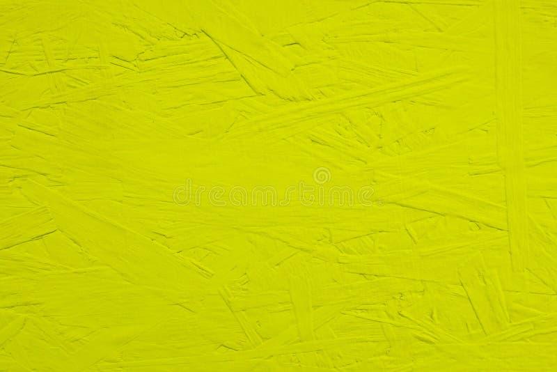 De raad schilderde van gele kleur De gele achtergrond van de de muurtextuur van OSB houten royalty-vrije stock fotografie