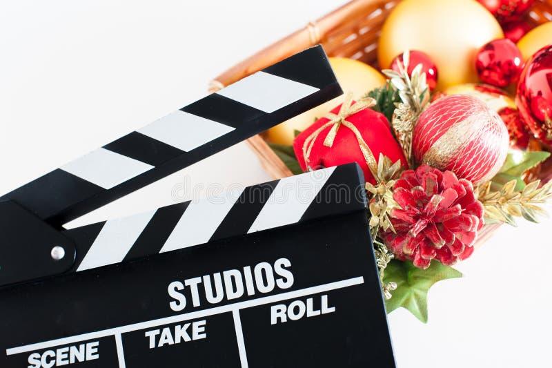 De raad van de filmklep en Kerstmisdecoratie stock foto