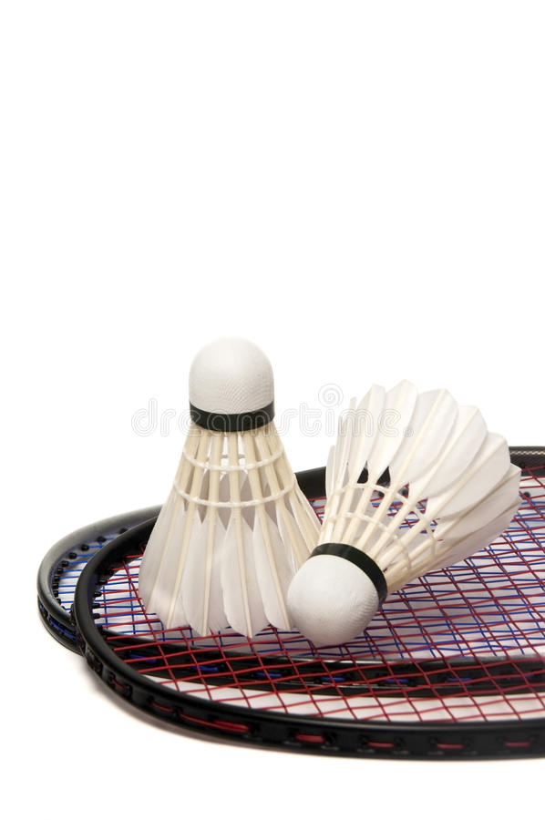 De racket van het badminton met tweeling geïsoleerdeg shuttle stock afbeeldingen