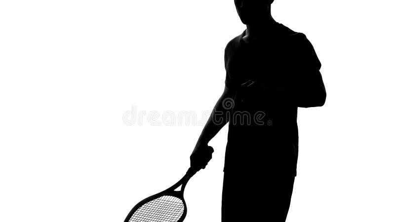 De racket van de de schaduwholding van de tennisspeler, die vóór de concurrentie, actieve hobby opwarmen royalty-vrije stock fotografie
