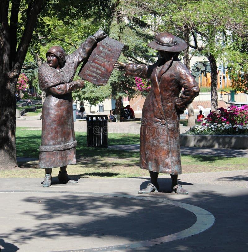 De Rechten van de Vrouwen van bronsstandbeelden stock afbeeldingen