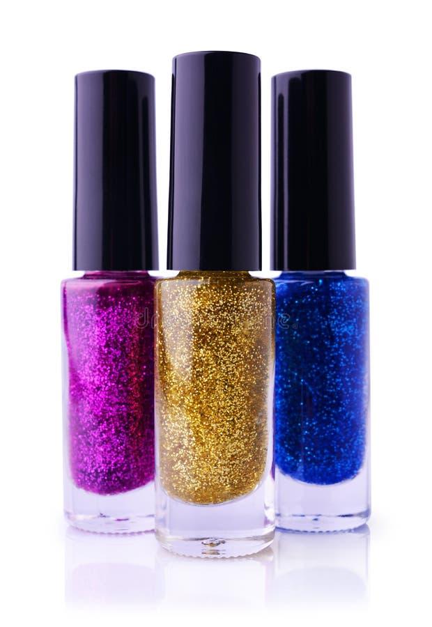 De reeks van multicolored glanzend nagellak met schittert royalty-vrije stock afbeeldingen