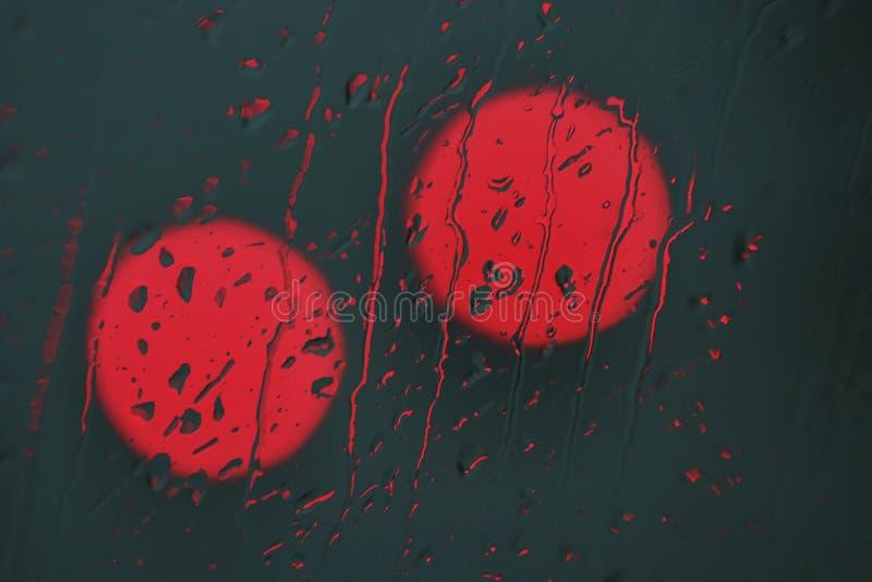 De regen van het rood licht royalty-vrije stock afbeeldingen