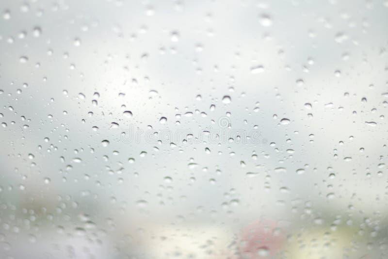 De Regen van de waterdaling, Regendruppelwater op glas Selectieve Nadruk stock fotografie