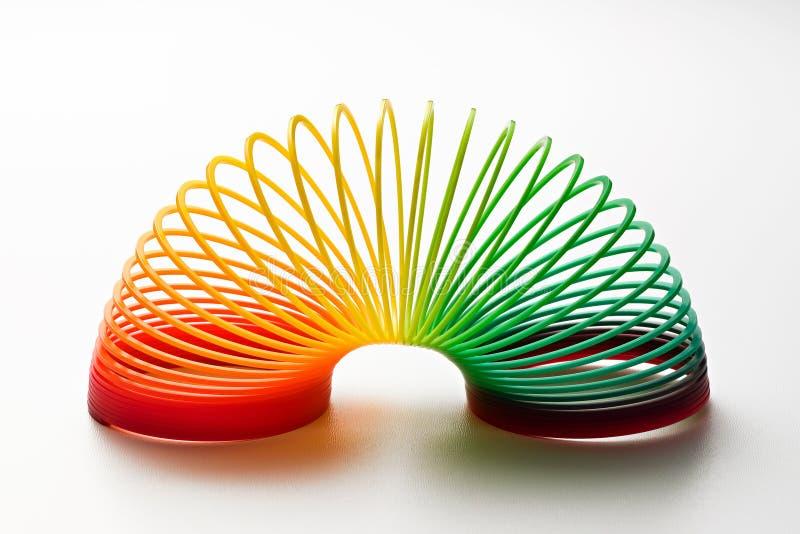 De regenboog kleurde stiekem stuk speelgoed stock foto