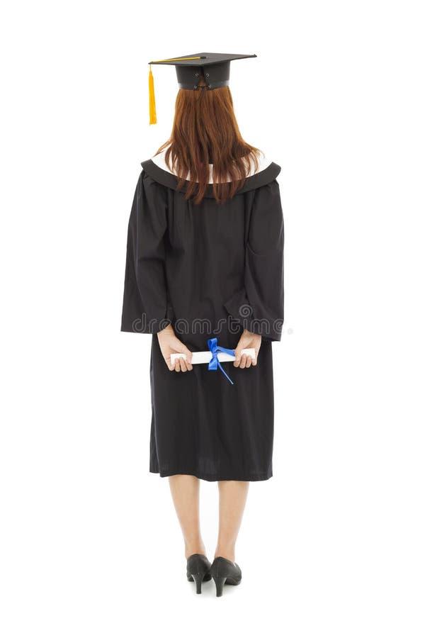 De retour de la belle jeune position intégrale de femme d'obtention du diplôme photo libre de droits