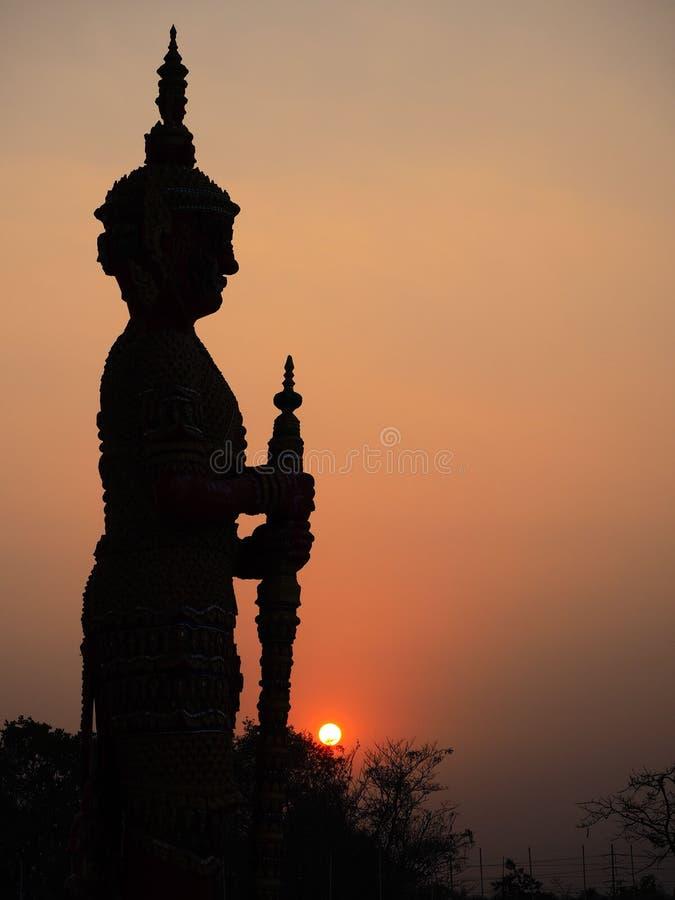 De reus in maatregel, zonsondergang Dit is traditionele andgeneric st stock foto's