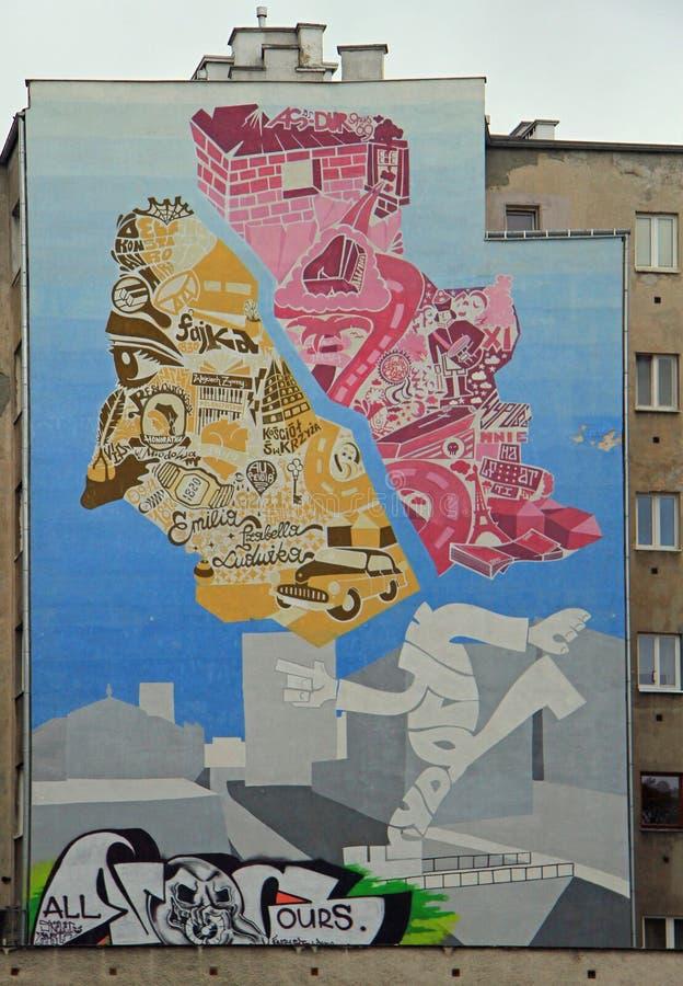 De reuzemuurschilderingen van de straatkunst bij de bouw van muren in Warshau, Polen stock foto