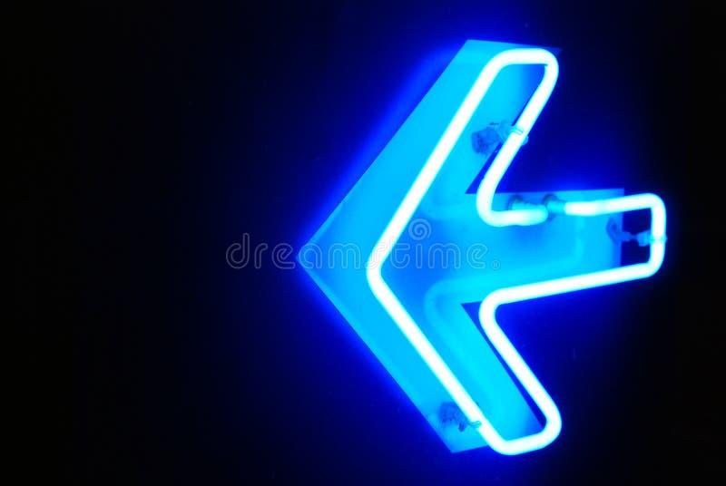 De richting van het neon stock afbeeldingen