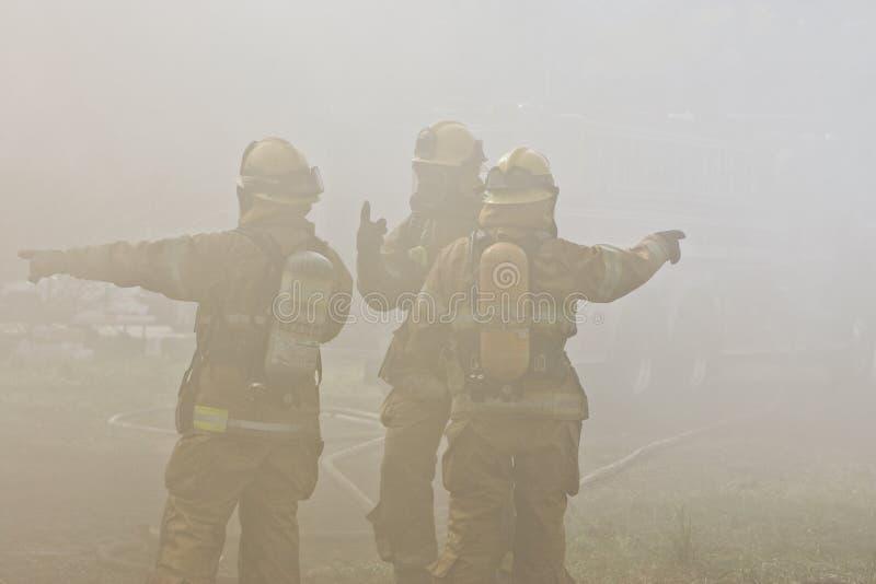 De Richtingen van brandbestrijders stock fotografie