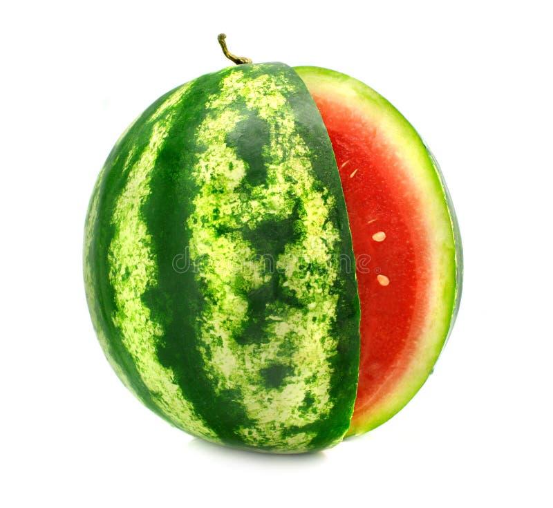 De rijpe fruitwatermeloen met besnoeiing is geïsoleerd stock fotografie