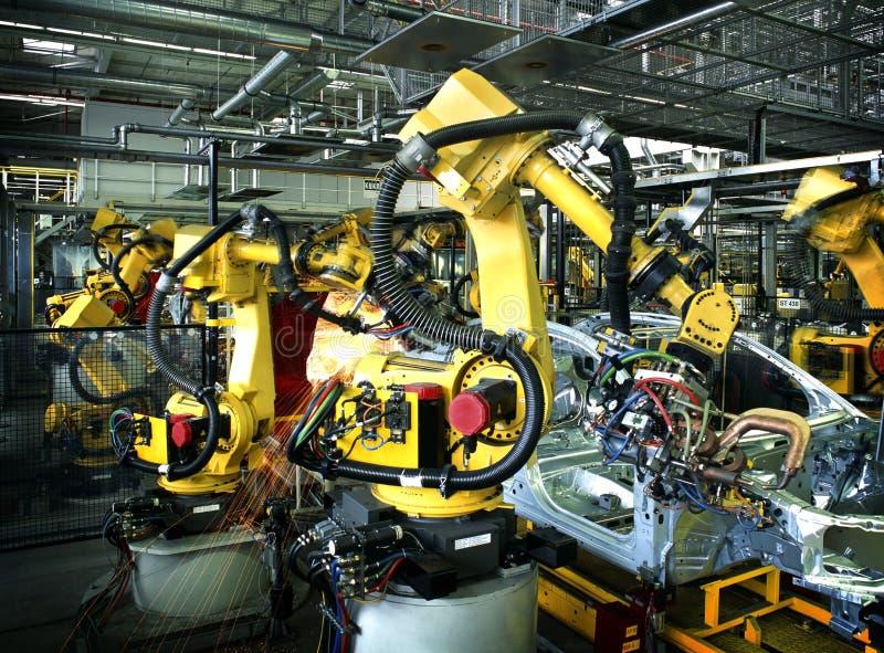 De robot van het lassen stock afbeelding