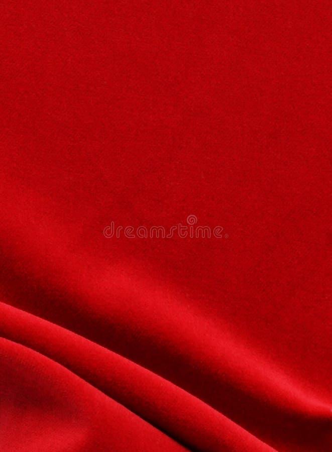 De rode achtergrond van de fluweeltextuur Feestelijke Kerstmis stock foto's