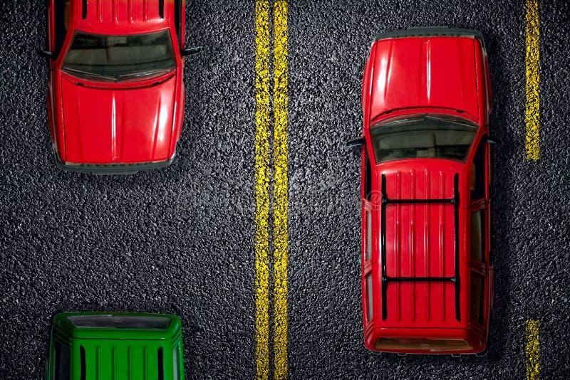 De rode auto op asfalt royalty-vrije stock afbeelding