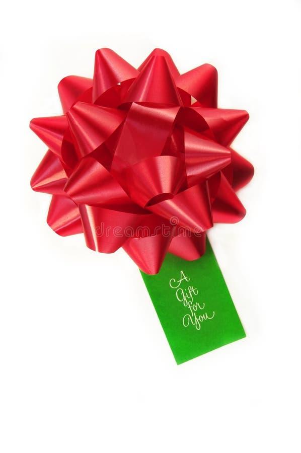 De rode Boog van de Gift met Markering royalty-vrije stock foto
