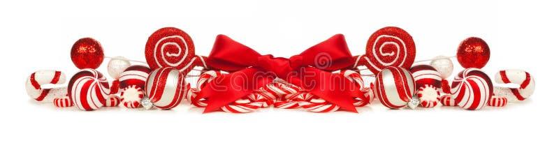 De rode en witte Kerstmissnuisterijen, bogen en grens van het suikergoedriet stock afbeelding
