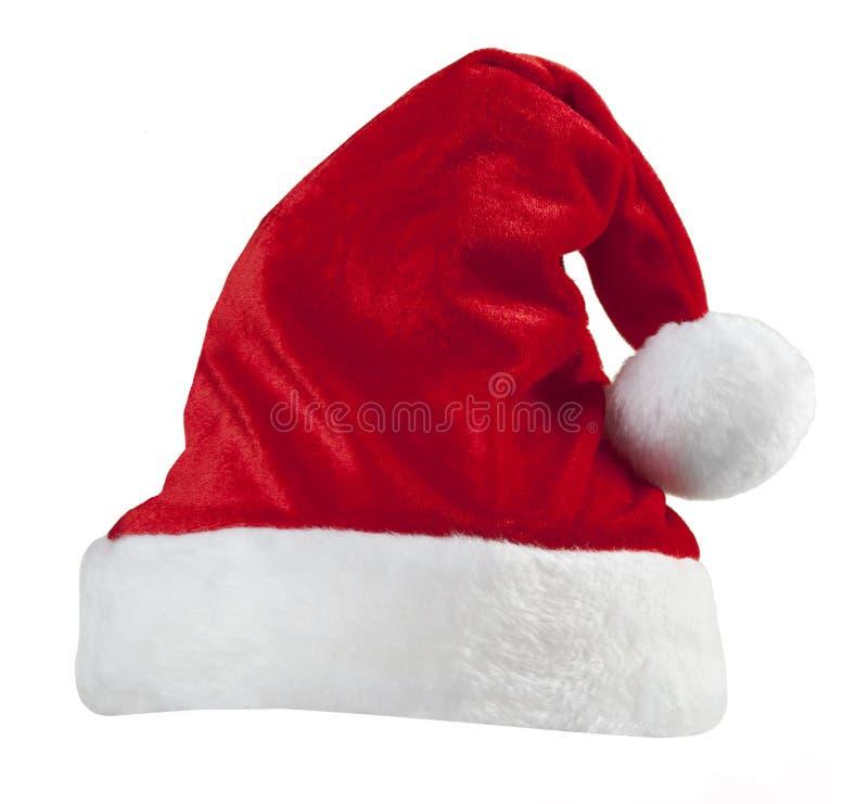 De rode geïsoleerdet hoed van de Kerstman stock foto's