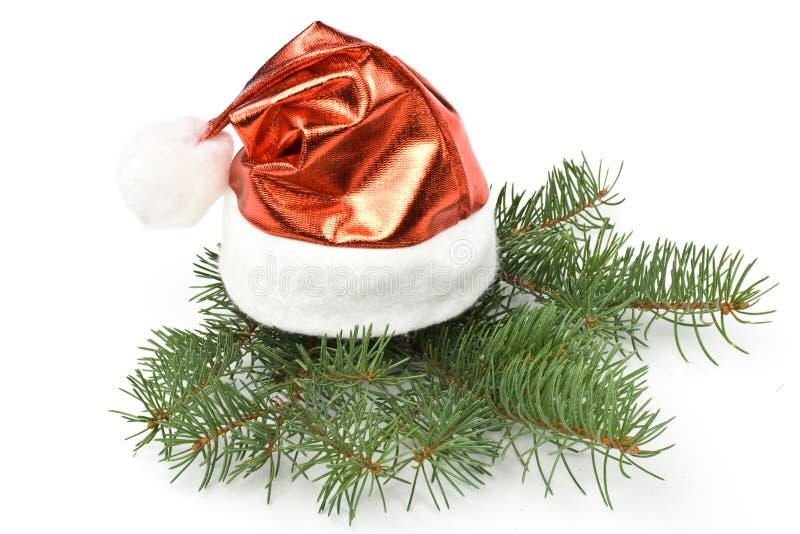 De rode hoed van de kerstman en sparrentak royalty-vrije stock fotografie