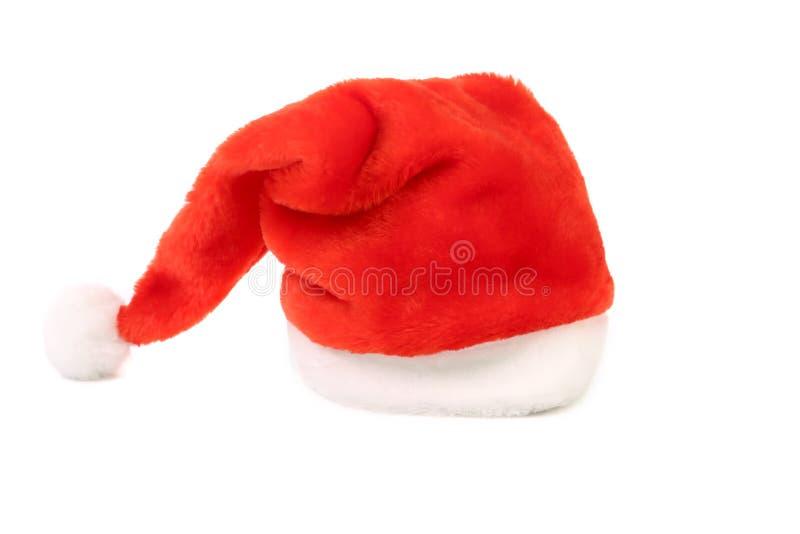 De rode hoed van Santa Claus. stock afbeelding