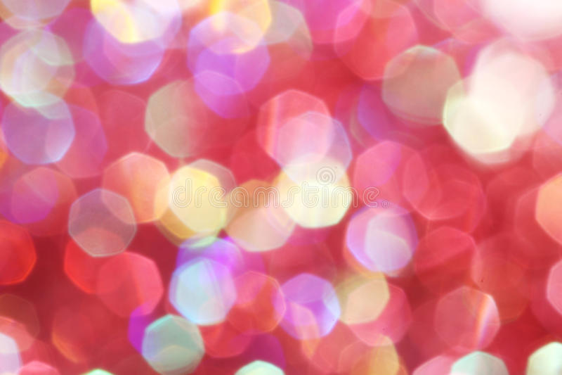 De rode, roze, witte, gele en turkooise zachte lichten vatten achtergrond samen - donkere kleuren stock foto