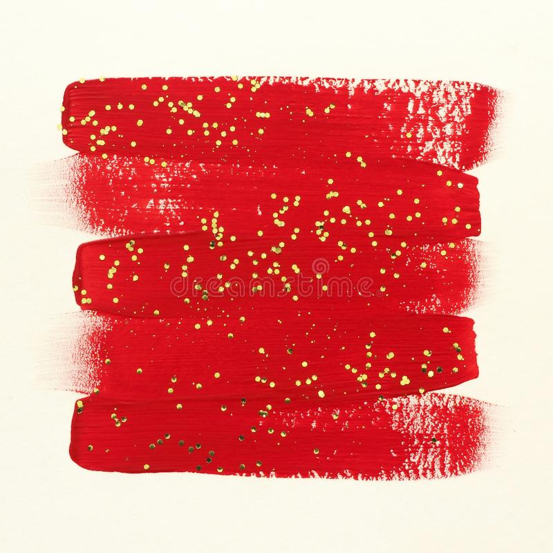 De rode slagen van de verfborstel met goud schitteren stock fotografie
