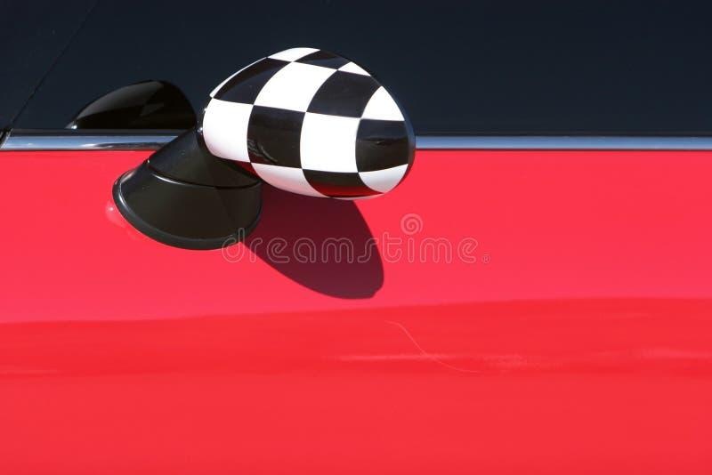 De rode spiegel van Mini Cooper sideview stock afbeeldingen