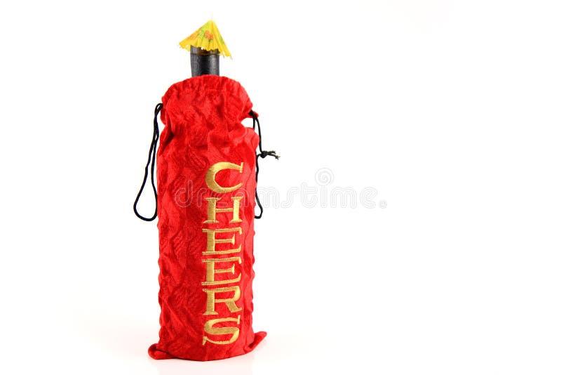 De rode zak van de giftfles royalty-vrije stock fotografie