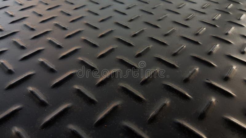 De roestige zwarte plaat van het het ijzermetaal van het diamantpatroon stock fotografie