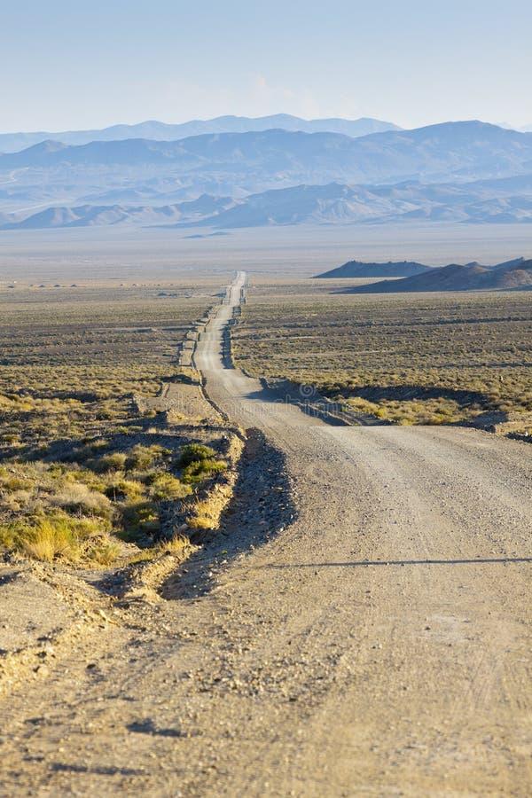 De Rolling Weg van de Woestijn royalty-vrije stock afbeeldingen