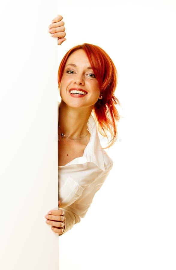 De roodharige van de vrouw over wit stock foto
