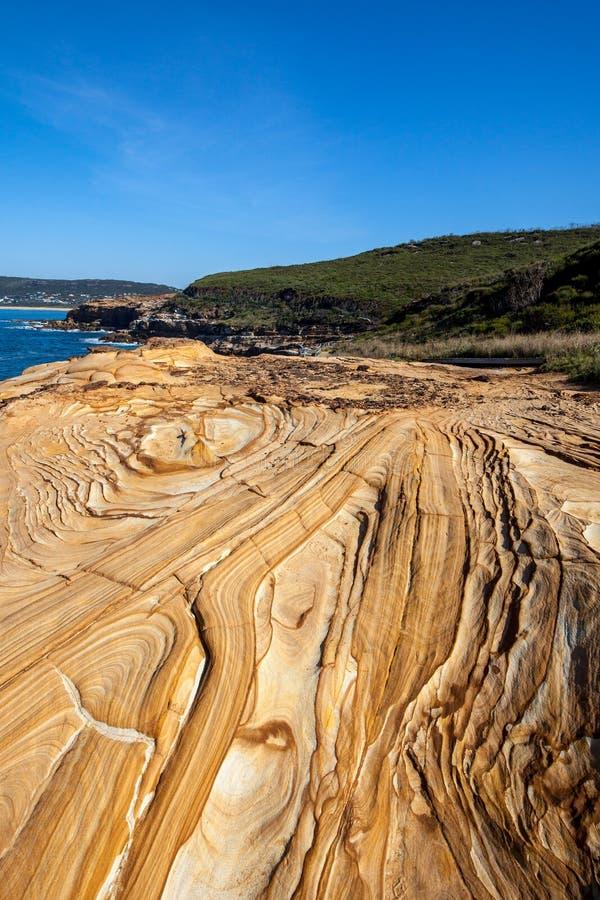 De rotsen van het Bouddistrand met patronen, Nieuw Zuid-Wales, Australië royalty-vrije stock foto's