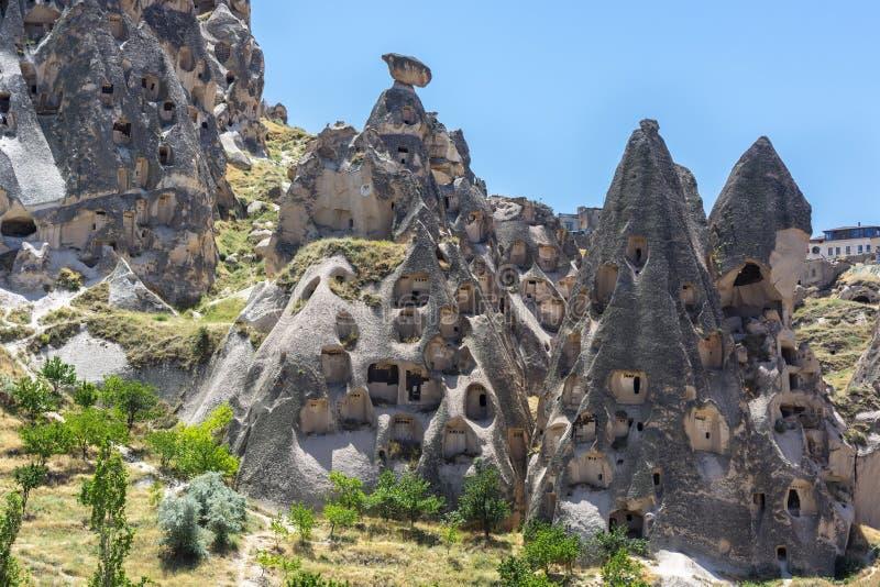 De rotsvormingen van feeschoorstenen in Cappadocia, centraal Turkije stock foto