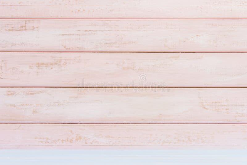 De roze achtergrond van de pastelkleur houten muur Vlak leg stock afbeelding