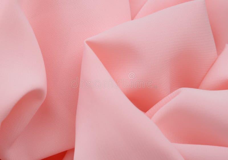 De roze achtergrond van stoffentexturen, ongelijke stof stock afbeeldingen