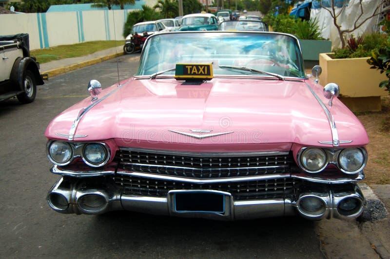 De roze Auto van de Taxi Cadillac royalty-vrije stock afbeeldingen