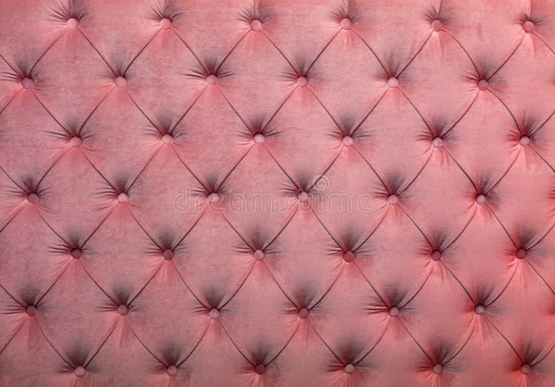 De roze capitone doorgenaaide textuur van de stoffenstoffering royalty-vrije stock fotografie