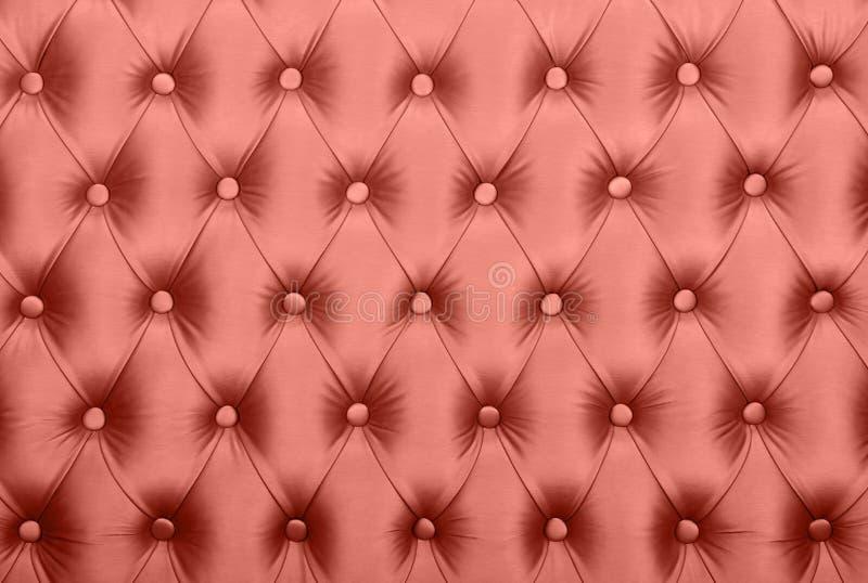 De roze capitone doorgenaaide textuur van de stoffenstoffering stock foto's