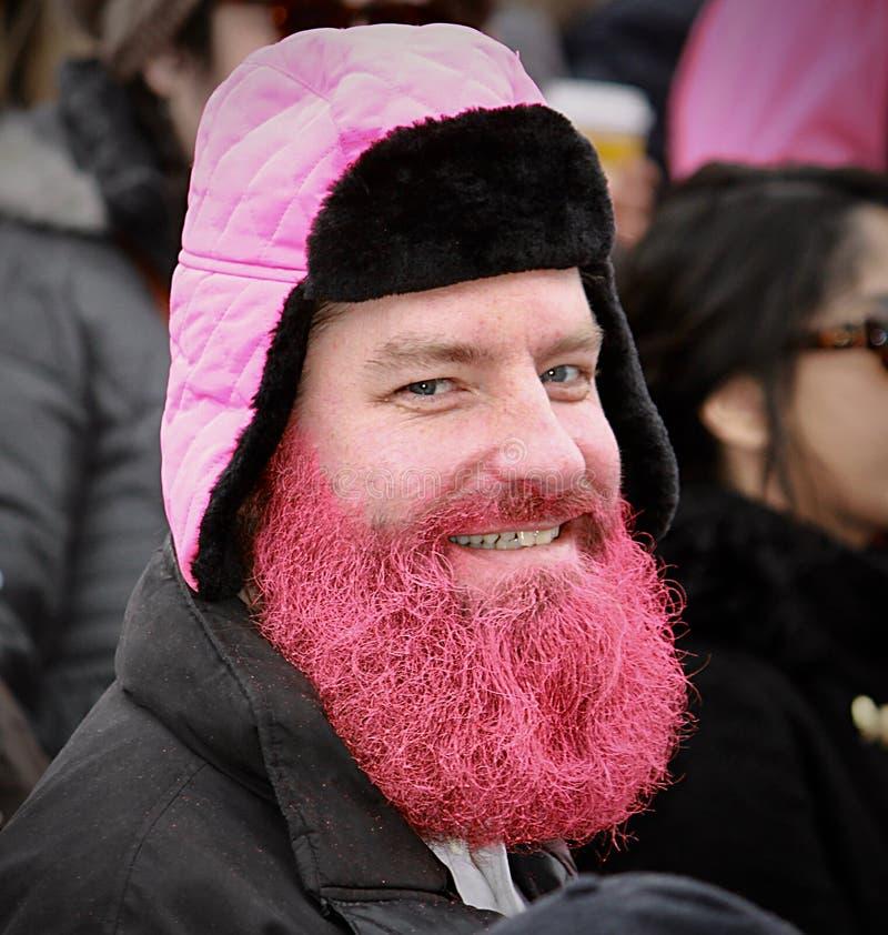 De roze gebaarde man steunt vrouwen` s verzameling royalty-vrije stock afbeelding
