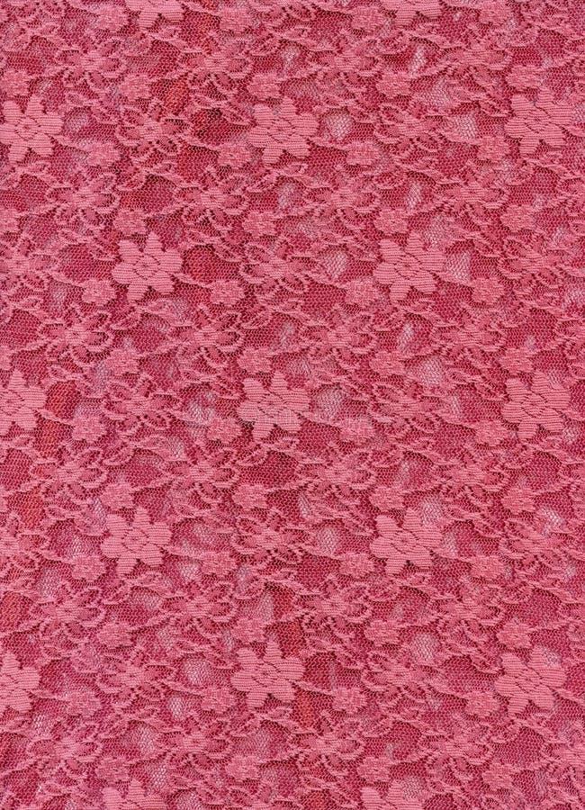 De roze textieltextuur van de kantstof royalty-vrije stock foto