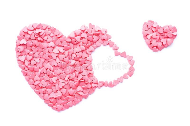 De roze vlieg van het Suikergoedhart uit De dagconcept van de valentijnskaart ` s stock fotografie