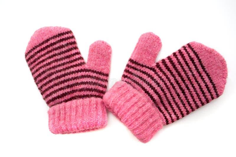 De roze vuisthandschoenen van het kind met zwarte streep stock foto