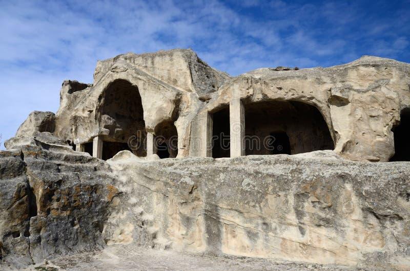 De ruïnes van de holcluster in de oude stad van Uplistsikhe, oostelijk Georgië stock afbeeldingen