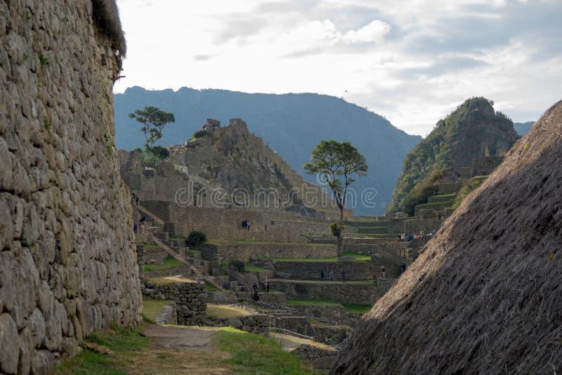 De ruïnes van Machupicchu en zijn huizen in Peru stock foto