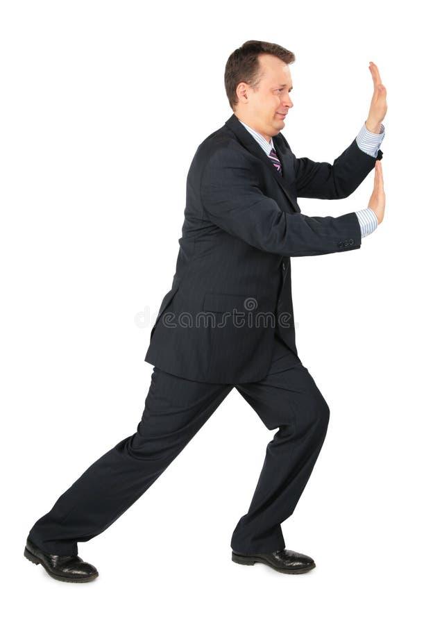 De rust van de zakenman handen tegen muur stock foto