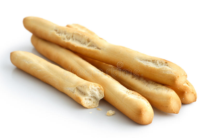 De rustieke stokken van het grissinibrood Geïsoleerd op wit Gebroken met cru royalty-vrije stock foto's