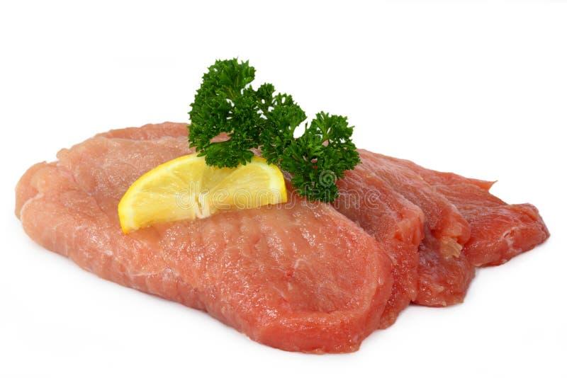 De ruwe schnitzel van de varkensvleeskotelet stock foto
