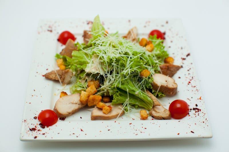 De salade met greens op een witte achtergrond stock foto
