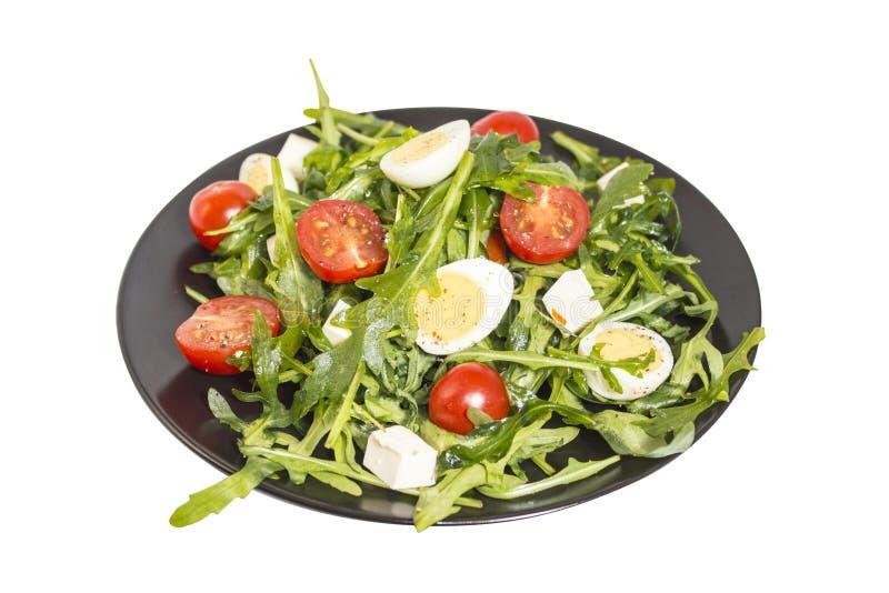 De salade van kwartelseieren op een donkere plaat stock afbeelding