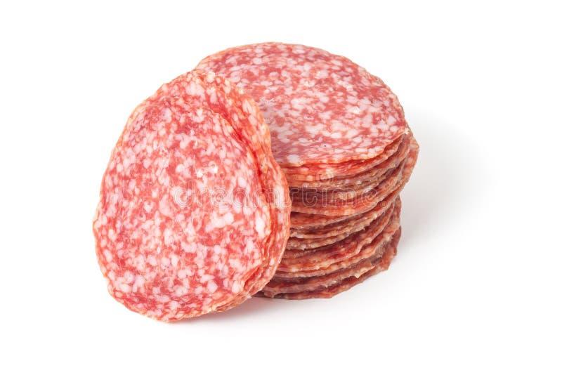 De salami van plakken die op een wit wordt geïsoleerdh stock foto's